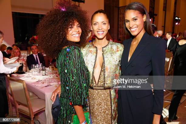 Tina Kunakey Noemie Lenoir and Cindy Bruna attend the amfAR Paris Dinner at Le Petit Palais on July 2 2017 in Paris France