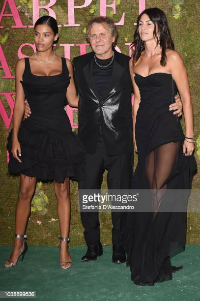 Tina Kunakey, Renzo Rosso and Arianna Alessi attend the Green Carpet Fashion Awards at Teatro Alla Scala on September 23, 2018 in Milan, Italy.