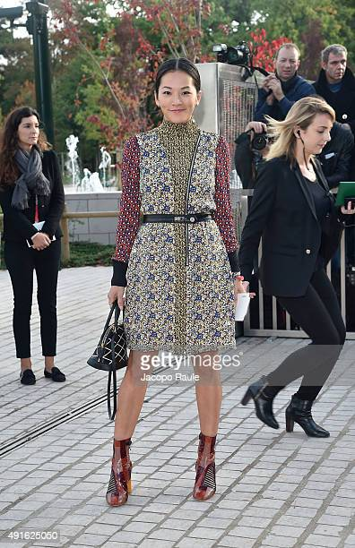 Tina Leung arrives at the Louis Vuitton Fashion Show during the Paris Fashion Week S/S 2016 Day Nine on October 7 2015 in Paris France