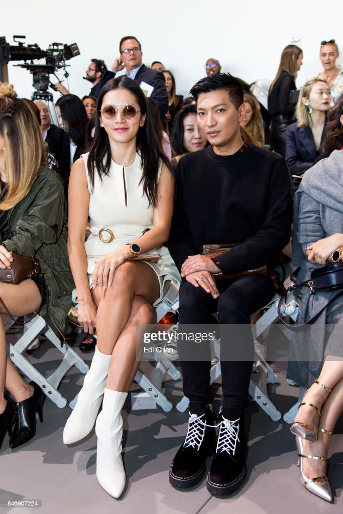 Tina Leung & Bryan Grey Yambao attend the Michael Kors runway show during New York Fashion Week at Spring Studios on September 13, 2017 in New York City.