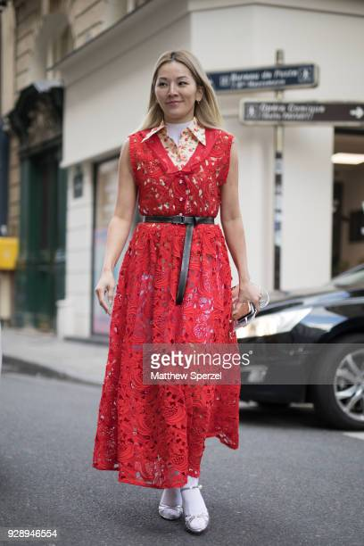 Tina Leung is seen on the street attending Jourden during Paris Women's Fashion Week A/W 2018 wearing a red lace dress on March 6 2018 in Paris France