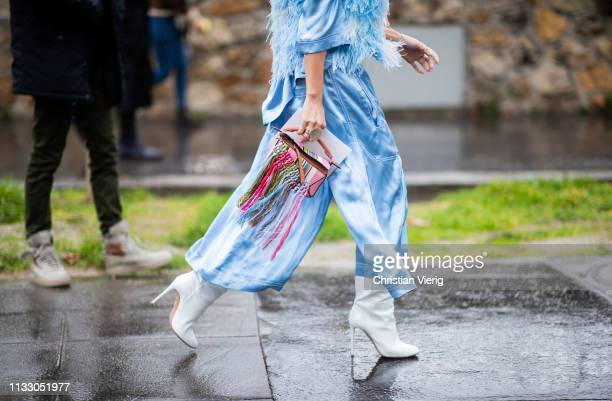 Tina Leung is seen wearing blue dress, mini bag with fringes outside Loewe during Paris Fashion Week Womenswear Fall/Winter 2019/2020 on March 01,...