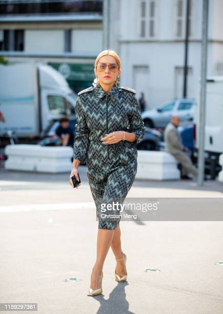 Tina Leung is seen wearing dress with pattern outside Acne during Paris Fashion Week - Haute Couture Fall/Winter 2019/2020 on June 30, 2019 in Paris,...