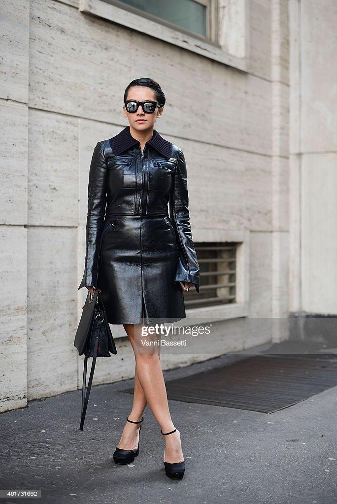 Tina Leung poses wearing a Calvin Klein dress during day 2 of Milan Menswear Fashion Week Fall/Winter 2015/2016 on January 18, 2015 in Milan, Italy.