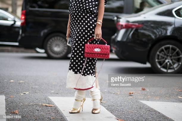 Tina Leung poses wearing Miu Miu after the Miu Miu show at the Palais de Iena during Paris Fashion Week SS19 Womenswear on October 2 2018 in Paris...
