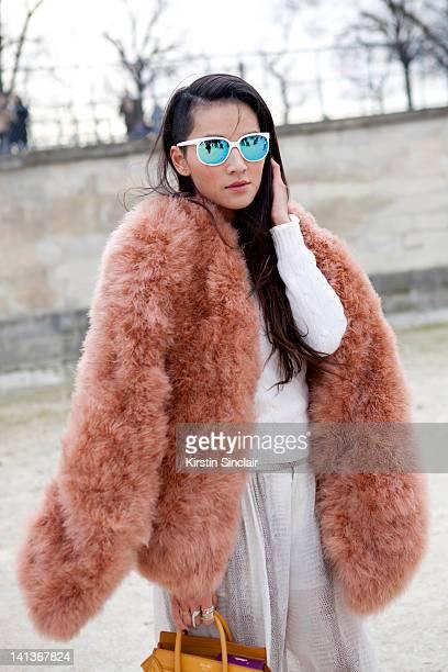 Tina Leung stylist wearing a Giorgio Armani jacket Ralph Lauren sweater Zara trousers Shirt from Hong Kong and a Celine Bag at Paris Fashion Week...