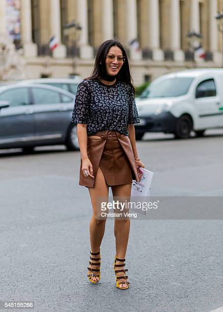 Tina Leung wearing a brown leather skirt outside Chanel during Paris Fashion Week Haute Couture F/W 2016/2017 on July 5 2016 in Paris France