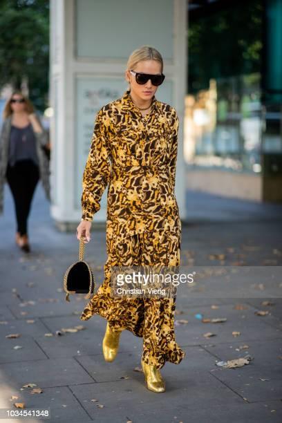 Tina Leung wearing dress with animal print is seen outside Nicholas Kirkwood during London Fashion Week September 2018 on September 16 2018 in London...