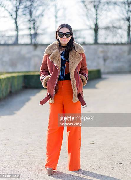 Tina Leung wearing orange pants and a shearling fur jacket outside Elie Saab during the Paris Fashion Week Womenswear Fall/Winter 2016/2017 on March...