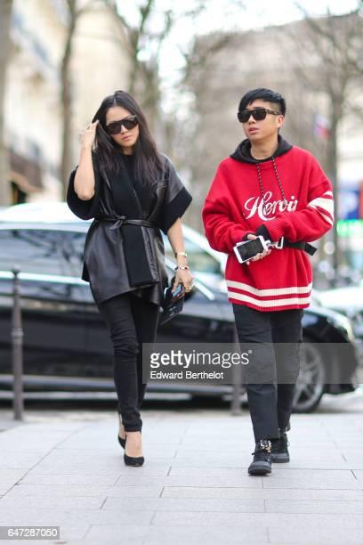 Tina Leung wears a black kimono and black pants outside the Balmain show during Paris Fashion Week Womenswear Fall/Winter 2017/2018 on March 2 2017...