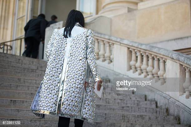 Tina Leung wears a reflective silver Courreges coat outside the Giambattista Valli show at Grand Palais on October 3 2016 in Paris France