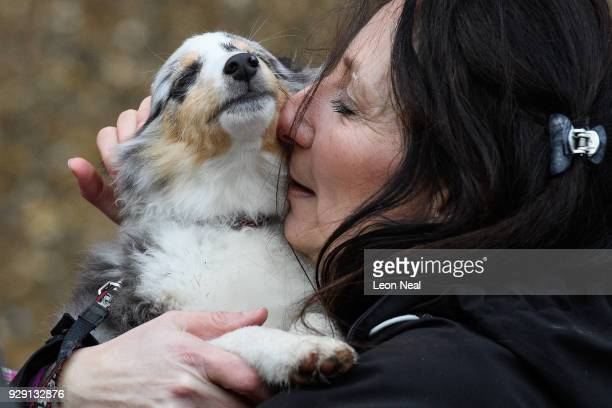 Tina Lowes hugs her Shetland Sheepdog as she arrives for the Crufts dog show at the NEC Arena on March 8 2018 in Birmingham England The annual...