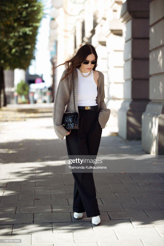 Tina Lundin wearing black pants, white top and brown