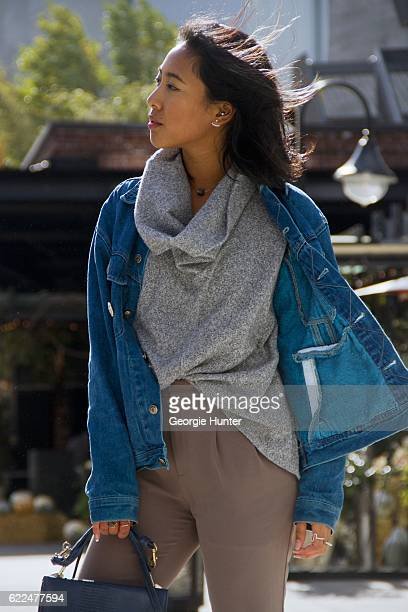Tina Maria Tran wearing men's vintage denim jacket by Levi's nude high waisted soft ponte jogger pants by Uniqlo grey cotton sweater with oversized...