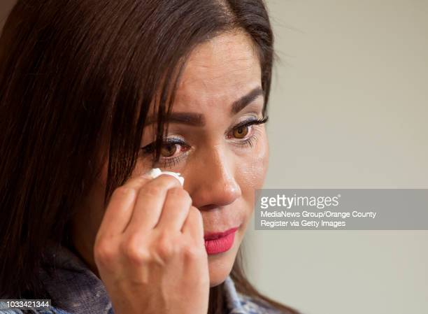 Tina Marie Costa sheds a tear during a press conference at the Santa Ana Police Station to discuss how through her and other family members DNA...