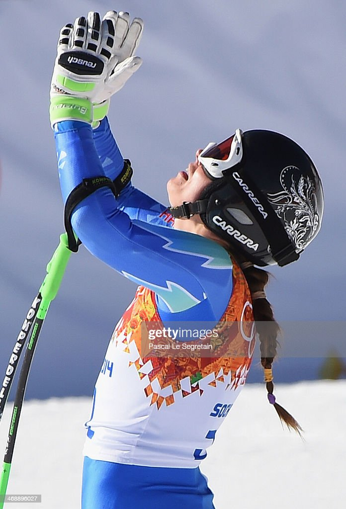Tina Maze of Slovenia celebrates after a run during the Alpine Skiing Women's Downhill on day 5 of the Sochi 2014 Winter Olympics at Rosa Khutor Alpine Center on February 12, 2014 in Sochi, Russia.