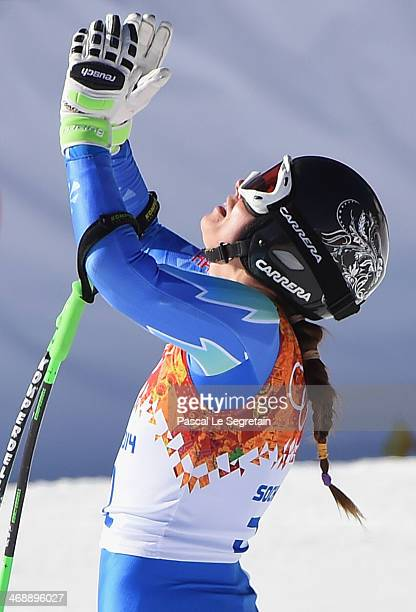 Tina Maze of Slovenia celebrates after a run during the Alpine Skiing Women's Downhill on day 5 of the Sochi 2014 Winter Olympics at Rosa Khutor...