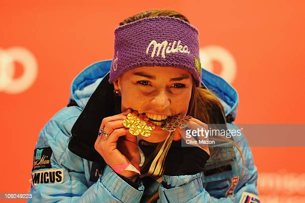 Tina Maze of Slovenia celebrates at the medal plaza with her gold medal for victory in the Women's Giant Slalom and silver medal for finishing second...