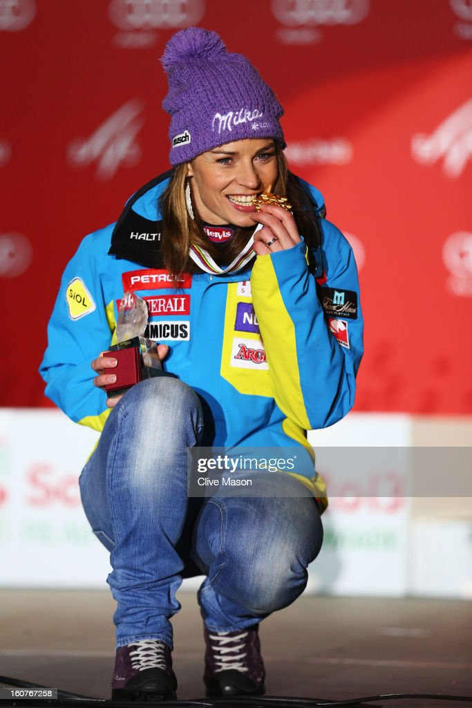 Tina Maze of Slovenia celebrates with her gold medal after winning the Women's Super G event during the Alpine FIS Ski World Championships on February 5, 2013 in Schladming, Austria.