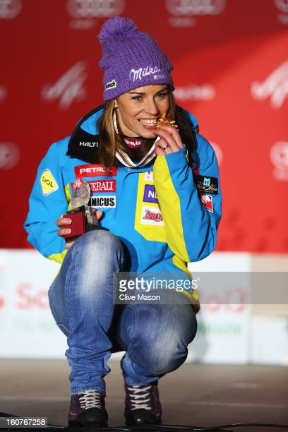 Tina Maze of Slovenia celebrates with her gold medal after winning the Women's Super G event during the Alpine FIS Ski World Championships on...