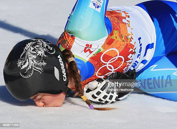 Tina Maze of Slovenia kisses the ground after her run during the Alpine Skiing Women's Downhill on day 5 of the Sochi 2014 Winter Olympics at Rosa...