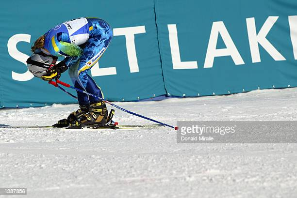 Tina Maze of Slovenia puts her head in her hands after competing in the women's giant slalom during the Salt Lake City Winter Olympic Games on...