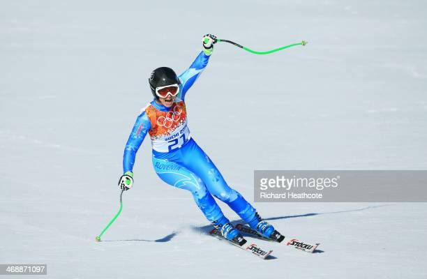 Tina Maze of Slovenia reacts after her run during the Alpine Skiing Women's Downhill on day 5 of the Sochi 2014 Winter Olympics at Rosa Khutor Alpine...