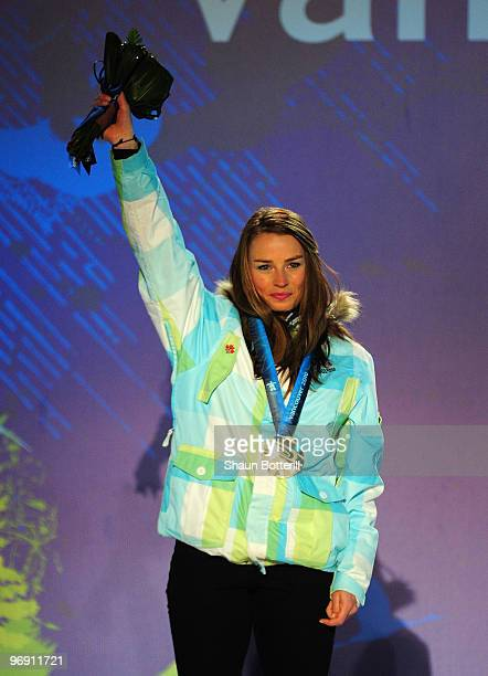 Tina Maze of Slovenia receives the silver medal during the medal ceremony for the women's superg alpine skiing held at the Whistler Medals Plaza on...