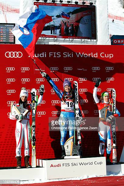 Tina Maze of Slovenia takes 1st place Anna Fenninger of Austria takes 2nd place Fabienne Suter of Switzerland takes 3rd place during the Audi FIS...