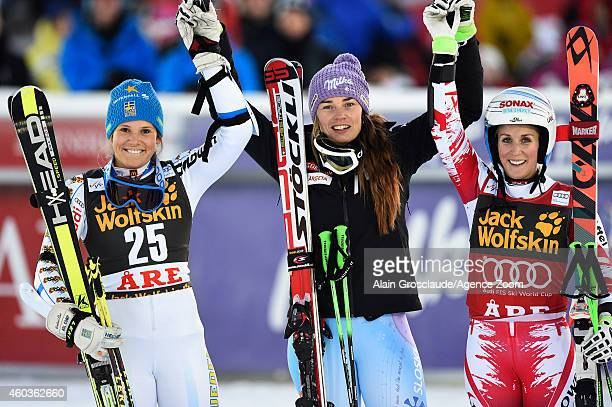 Tina Maze of Slovenia takes 1st place Sara Hector of Sweden takes 2nd place EvaMaria Brem of Austria takes 3rd during the Audi FIS Alpine Ski World...