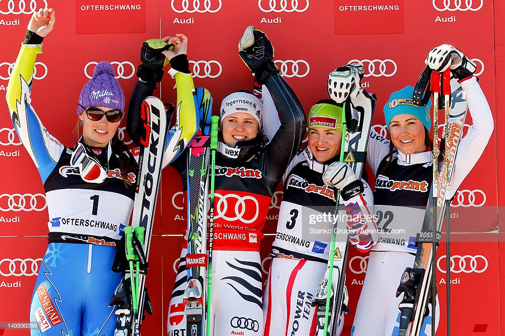 Tina Maze of Slovenia takes 2nd place, Viktoria Rebensburg of Germany takes 1st place, Elena Curtoni of Italy takes 3rd place, Elisabeth Goergl of Austria takes 3rd place during the Audi FIS Alpine Ski World Cup Women's Giant Slalom on March 2, 2012 in Ofterschwang, Germany.