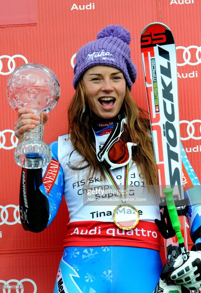 Tina Maze of Slovenia takes the globe for the overall World Cup Super G during the Audi FIS Alpine Ski World Cup Women's Super G on March 14, 2013 in Lenzerheide, Switzerland.