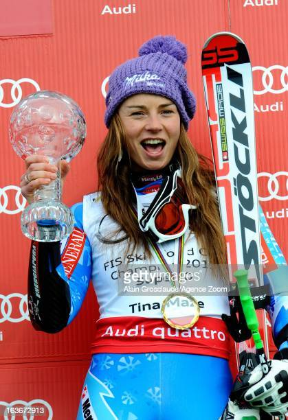 Tina Maze of Slovenia takes the globe for the overall World Cup Super G during the Audi FIS Alpine Ski World Cup Women's Super G on March 14 2013 in...