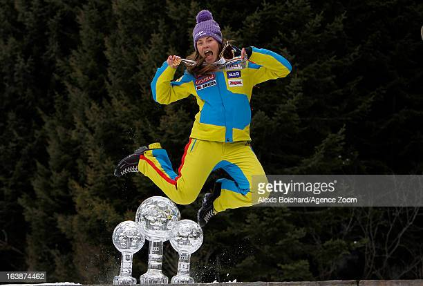 Tina Maze of Slovenia takes the globe for the overall World Cup during the Audi FIS Alpine Ski World Cup Women's Giant Slalom on March 17 2013 in...
