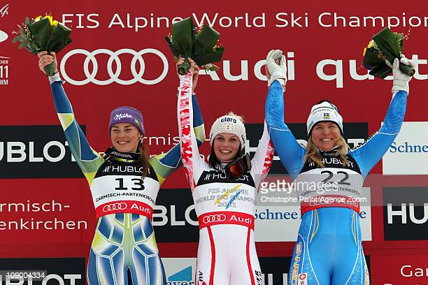 Tina Maze of Slovenia takes the silver medal Anna Fenninger of Austria takes the gold medal and Anja Paerson of Sweden takes the bronze medal during...
