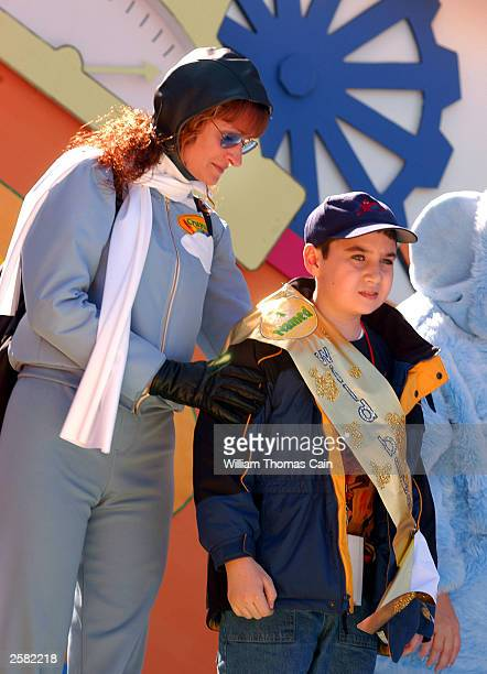Tina Mimlitsch dressed as Wild Blue Yonder stands on stage with 11yearold Mark Koffler of Brooklyn New York who named the color during Crayola...