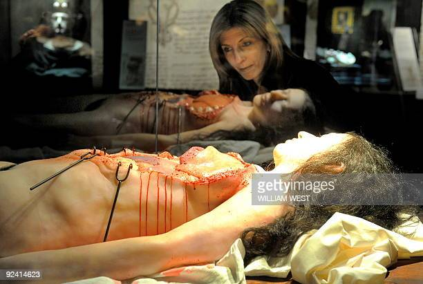 Tina Minichilli inspects a display at a Leonardo Da Vinci exhibition titled 'Anatomy to Robots' in Melbourne on October 28 2009 a world premiere...