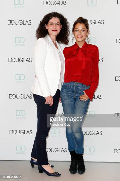 Tina Mueller and Anna Julia Kapfelsperger attend the reopening of the Douglas flagship store on October 9 2018 in Frankfurt am Main Germany