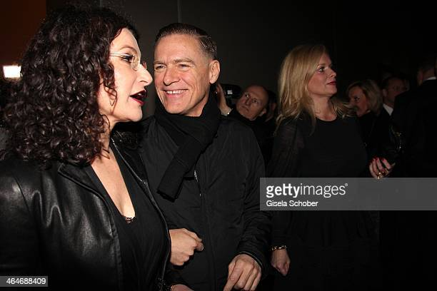 MUNICH GERMANY JANUARY Tina Mueller and Bryan Adams attend the presentation and vernissage of the calender 'THE ADAM BY BRYAN ADAMS' for Opel at Haus...