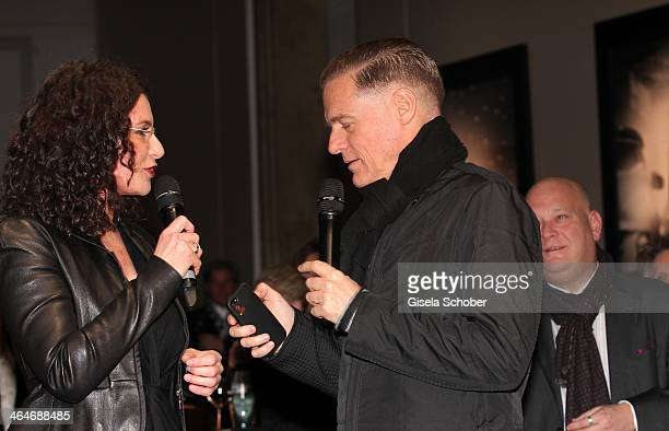 MUNICH GERMANY JANUARY Tina Mueller Bryan Adams attend the presentation and vernissage of the calender 'THE ADAM BY BRYAN ADAMS' for Opel at Haus der...