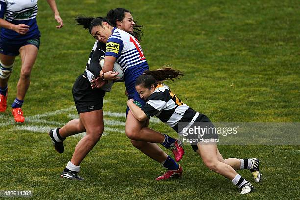 Tina Paulo of Northern United is tackled by Amanda Rasch and Helena Lawrence of OrientalRongotai during the Wellington Club Rugby Women's Final match...