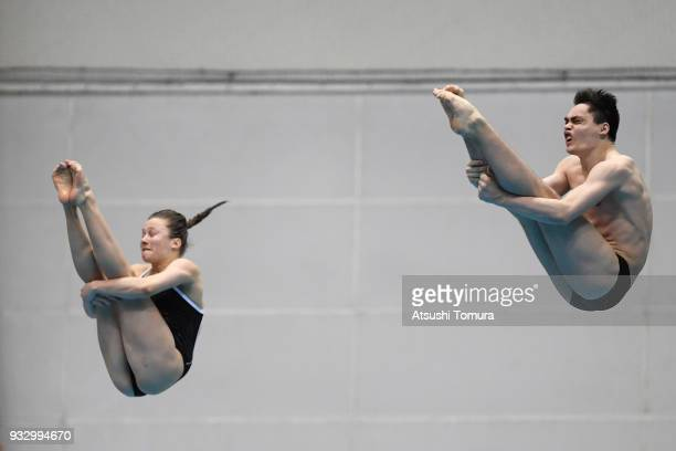 Tina Punzel and Lou Massenberg of Germany compete in the Mixed 3m Synchro Springboard final during day three of the FINA Diving World Series Fuji at...