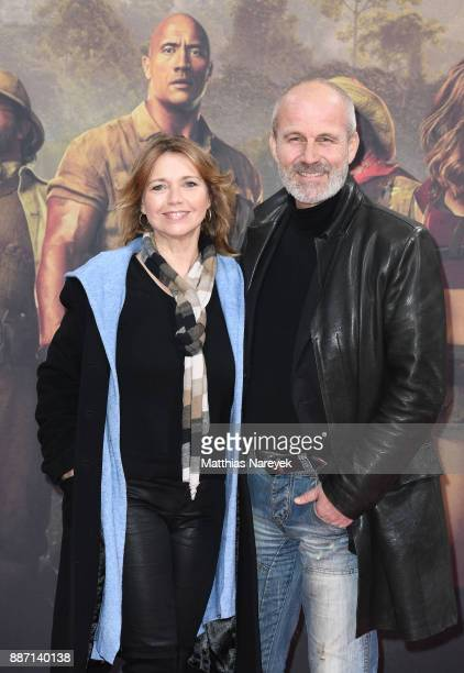 Tina Ruland and Claus G Oeldorp arrive for the German premiere of 'Jumanji Willkommen im Dschungel' at Sony Center on December 6 2017 in Berlin...