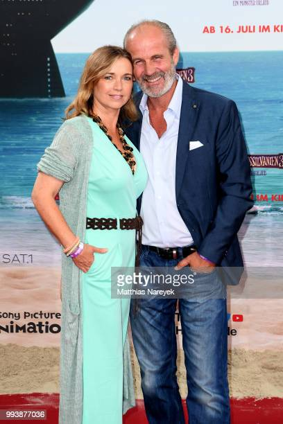 Tina Ruland and her husband Claus G Oeldorp attend the 'Hotel Transsilvanien 3' premiere at CineStar on July 8 2018 in Berlin Germany