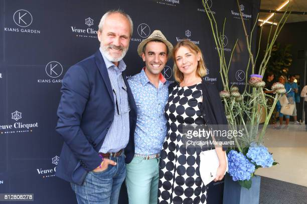 Tina Ruland her partner Claus Oeldrop and Kian ShamsDolatabadi attend the 'Kians Garden Flower Shop' Opening Event at Kantstrasse on July 11 2017 in...