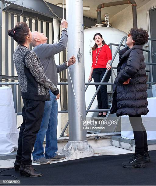 Tina Sinatra and AJ Lambert watch as flag is raised at the Sinatra 100 FlagRaising at Capitol Records Building on December 11 2015 in Los Angeles...