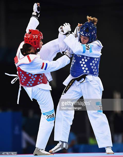 Tina Skaar of Norway and Reshmie Oogink of the Netherlands compete in the Women's 67kg Taekwondo Preliminary Round during day seven of the Baku 2015...