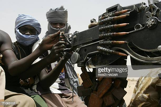 A picture taken 20 May 2006 shows rebels from the Sudan Liberation Movement in Tina a small village next to Tawila a town located 70 kms west of...