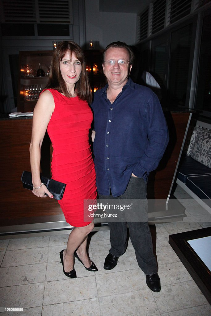 Tina Surmises-Roe and Robert Furniss-Roe attend private dinner hosted by Jay Z at Scarpetta, Fontainbleau Hotel on December 9, 2012 in Miami Beach, Florida.