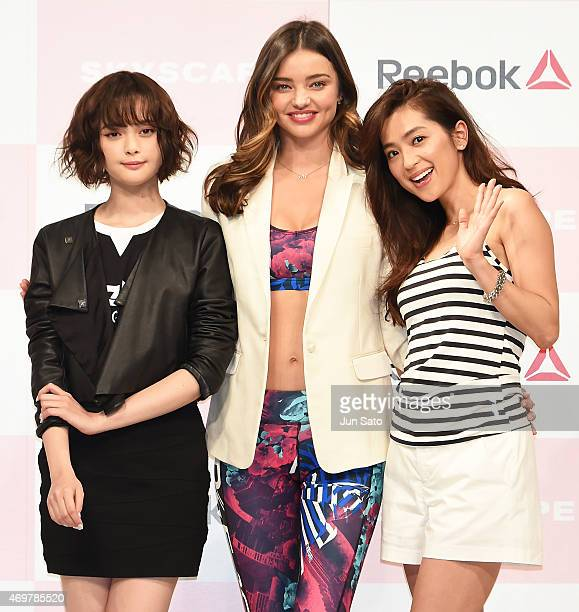 Tina Tamashiro Miranda Kerr and Anne Nakamura attend the promotional event for Reebok Skyscape at the Omotesando Hills on April 15 2015 in Tokyo Japan